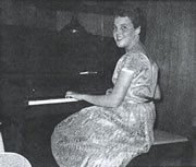 A picture of Wesla at a Piano